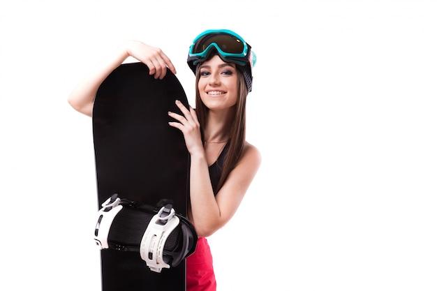 Giovane bella donna in nero corto canotta tenere snowboard Foto Premium