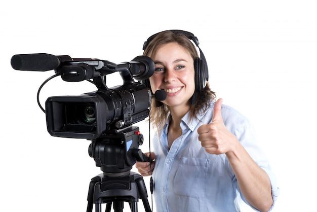 Giovane donna con una videocamera Foto Premium