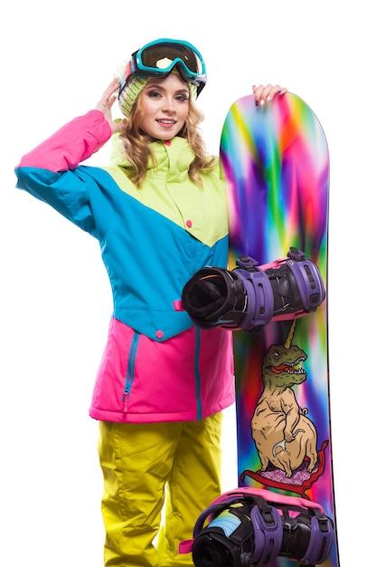 Giovane donna in tuta da sci con snowboard Foto Premium