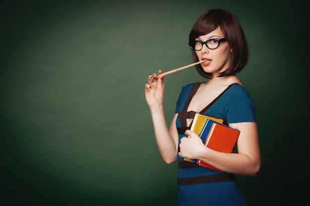 Giovane insegnante con puntatore Foto Premium