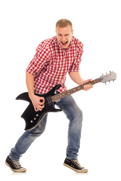 Giovane musicista con una chitarra Foto Gratuite