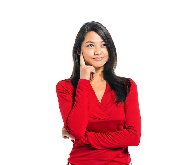 Giovane pensiero asiatico casuale della donna Foto Gratuite