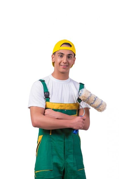 Giovane pittore di riparatore con il rullo isolato su bianco Foto Premium