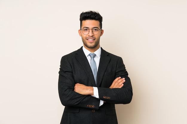 Giovane uomo bello dell'uomo d'affari sopra fondo isolato Foto Premium