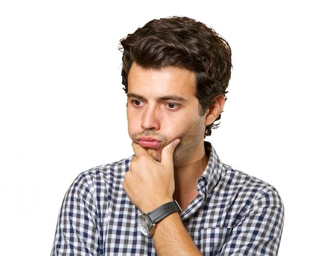 Giovane uomo pensoso isolato Foto Premium