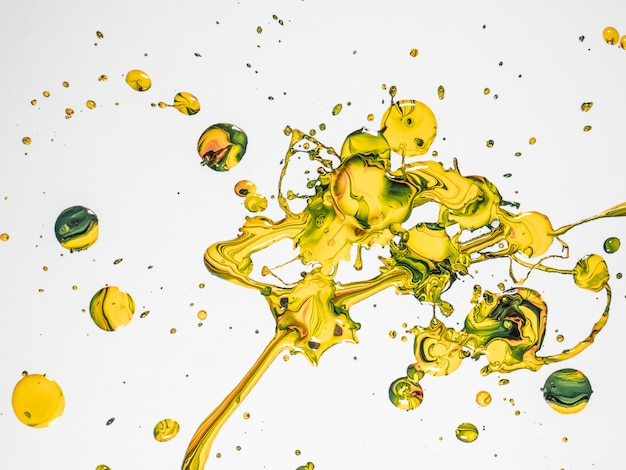 Gocce di vernice gialla e verde Foto Premium