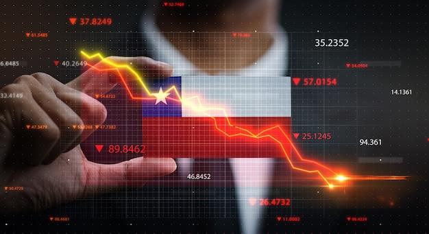 Grafico che cade davanti alla bandiera del cile. concetto di crisi Foto Premium