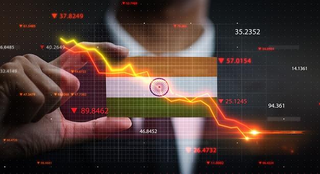 Grafico che cade davanti alla bandiera dell'india. concetto di crisi Foto Premium