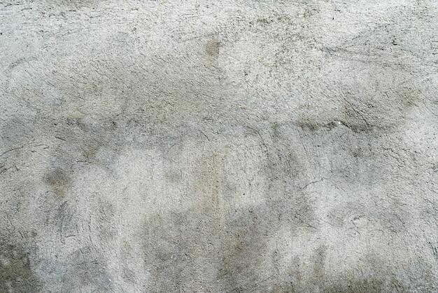Grungy parete grigia di una vecchia casa Foto Premium