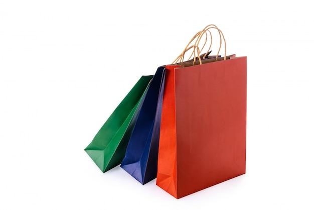 Gruppo di sacchetti della spesa di carta variopinti isolati Foto Premium