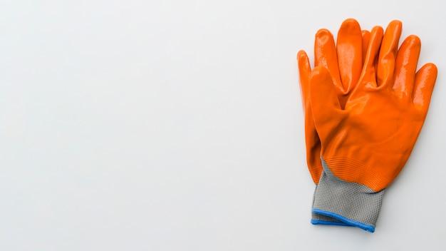 Guanti da giardinaggio arancione Foto Gratuite