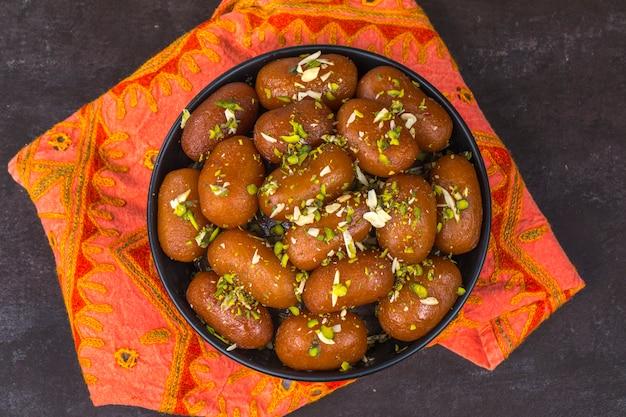 Gulab jamun dolce Foto Premium