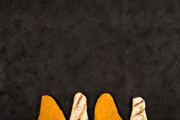 Gustose pepite di pollo composizione Foto Gratuite