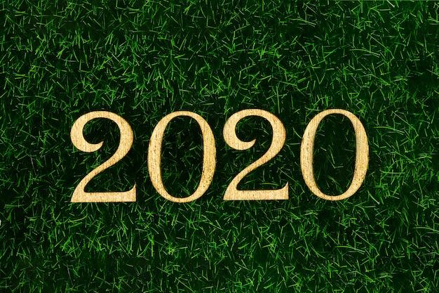 Happy new year 2020. testo creativo happy new year 2020 scritto in lettere di legno oro. Foto Premium