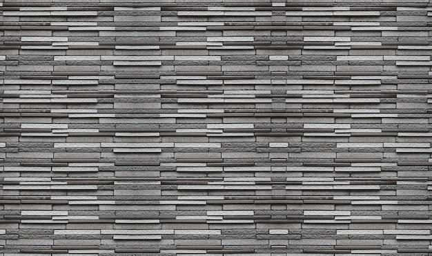 I vecchi blocchi stagionati del mattone del cemento del nero scuro stagionati impilano il fondo della superficie di struttura della parete. Foto Premium