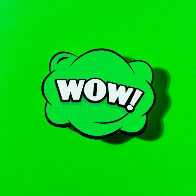 Icona comica di wow sopra l'illustrazione verde di vettore del fondo Foto Gratuite