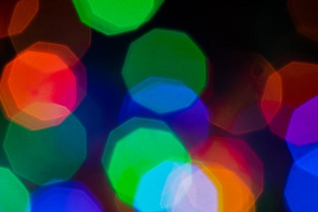 Il bokeh astratto variopinto accende il fondo luci di natale o del nuovo anno vaghe estratto nel fondo. Foto Premium
