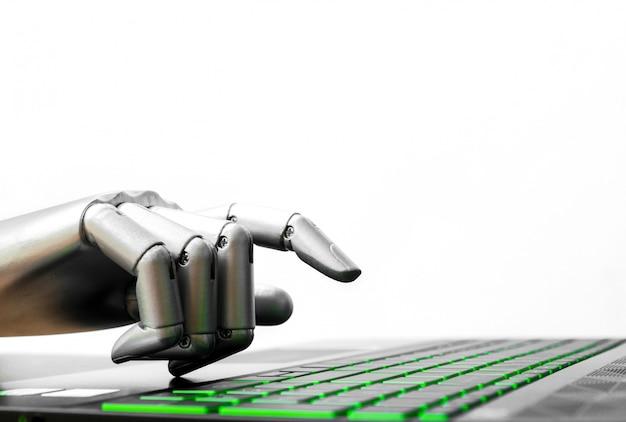 Il concetto del robot o il chatbot della mano del robot che preme la tastiera di computer entrano Foto Premium
