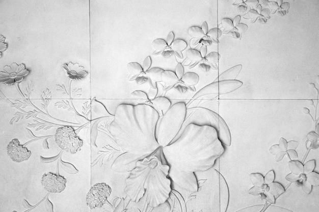 Il muro è decorato con fiori di piastrelle texture di sfondo