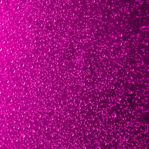 Il primo piano dell'acqua rosa astratta cade la priorità bassa Foto Gratuite
