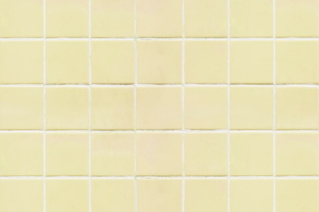 Il quadrato giallo ha piastrellato il fondo di struttura Foto Gratuite