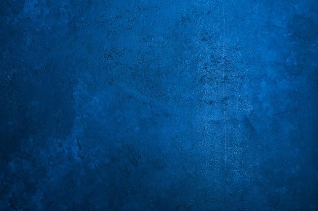 Il vecchio fondo di pietra di struttura ha tonificato il colore blu classico Foto Premium