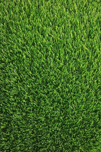 Immagine verticale del rigoglioso prato di erba verde per lo sfondo Foto Premium