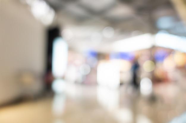 Interno astratto del centro commerciale della sfuocatura del grande magazzino Foto Gratuite