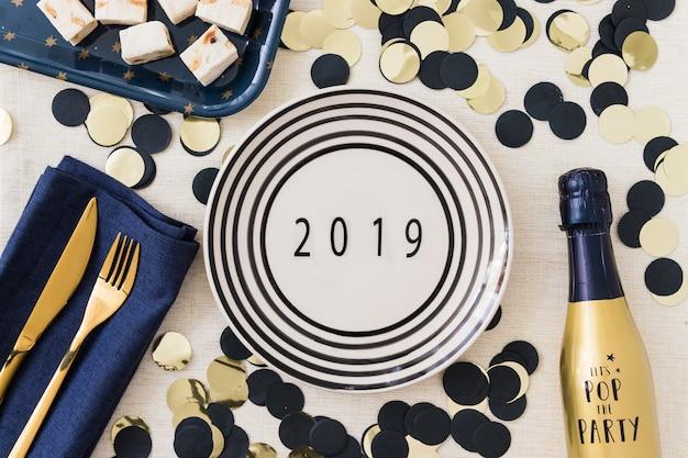 Iscrizione 2019 su placca con lustrini Foto Gratuite
