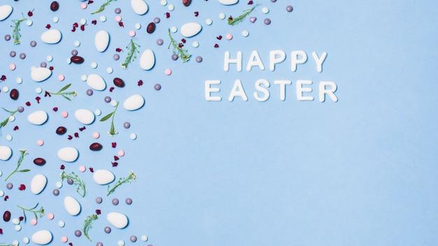 Iscrizione buona pasqua decorata da confetti e fiori Foto Gratuite