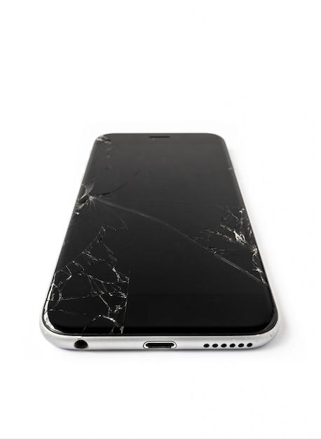 Isolato dello smartphone dello schermo rotto e incrinato Foto Premium