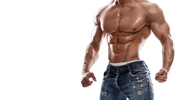 Jeans da portare dell'uomo muscolare Foto Premium