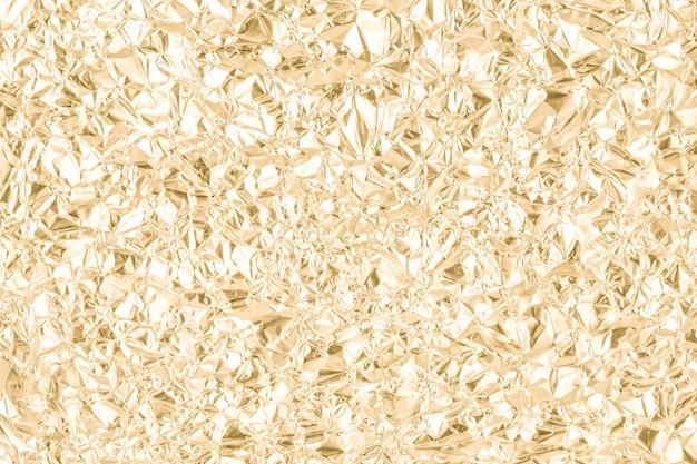 L'oro ha corrugato la priorità bassa di carta dell'estratto di struttura Foto Premium
