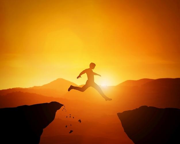 L'uomo che salta da una roccia all'altra. paesaggio di montagne al tramonto Foto Premium
