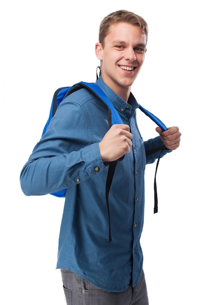 8bfd8e00f7 L'uomo in camicia blu, sorridente e con uno zaino | Scaricare foto ...