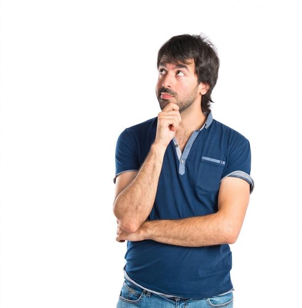 L'uomo pensiero su sfondo bianco isolato Foto Gratuite