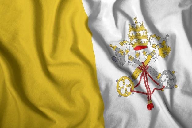 La bandiera del vaticano vola nel vento Foto Premium