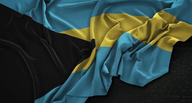 La bandiera delle bahamas rugosa su sfondo scuro 3d rendering Foto Gratuite