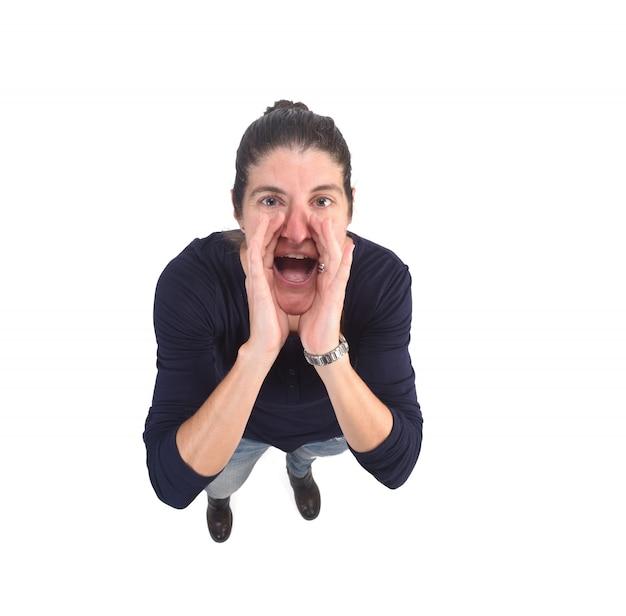 La donna che mette una mano in bocca e sta gridando Foto Premium