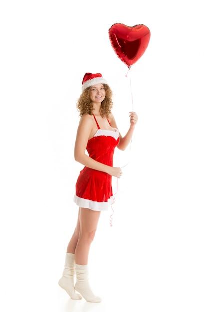 La donna con un palloncino cuore Foto Gratuite