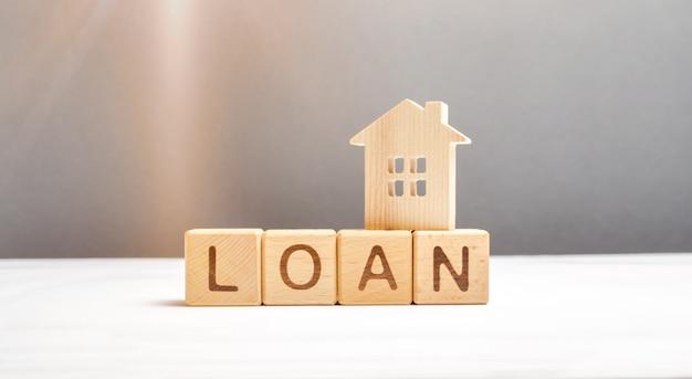 La figura della casa e il prestito dei cubi Foto Premium
