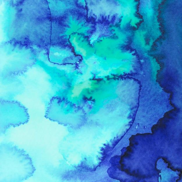 La macchia astratta dell'acquerello del turchese e del blu ha dipinto il fondo Foto Gratuite