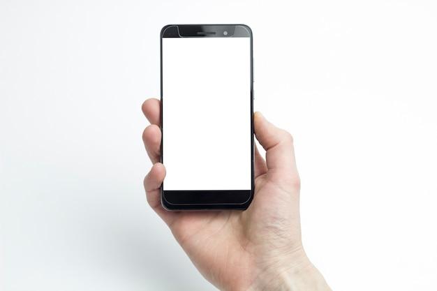 La Mano Di Un Uomo Che Tiene Uno Smartphone Su Uno Sfondo Bianco