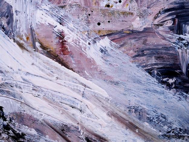La mano disegna il fondo e la struttura astratti del colpo della spazzola della pittura ad olio variopinta. Foto Premium
