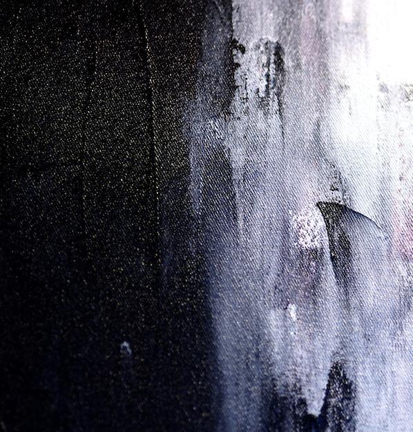 La mano disegna il fondo e la struttura astratti della pittura ad olio variopinta. Foto Premium