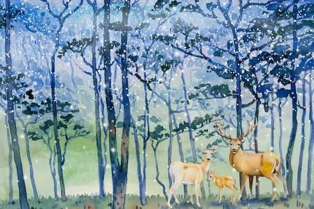 La neve dei dipinti cade nell'inverno della foresta e nella famiglia dei cervi. Foto Premium