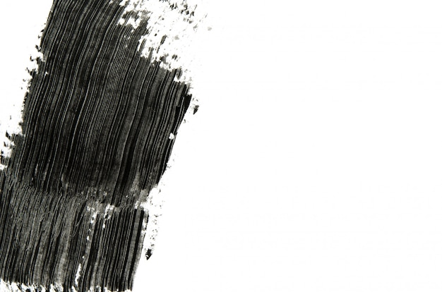 La spazzola nera della mascara segna il fondo con copyspace Foto Premium