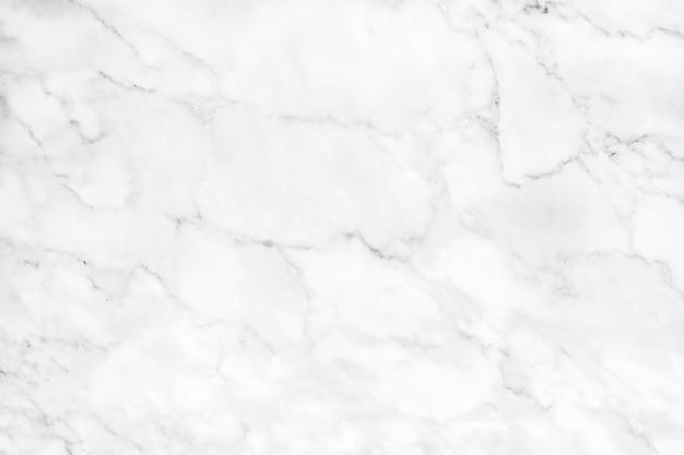 La struttura di marmo bianca naturale per le mattonelle della pelle wallpaper il fondo lussuoso Foto Premium
