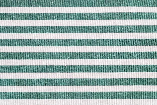 La superficie del primo piano della borsa del tessuto bianco e verde ha strutturato il fondo Foto Premium
