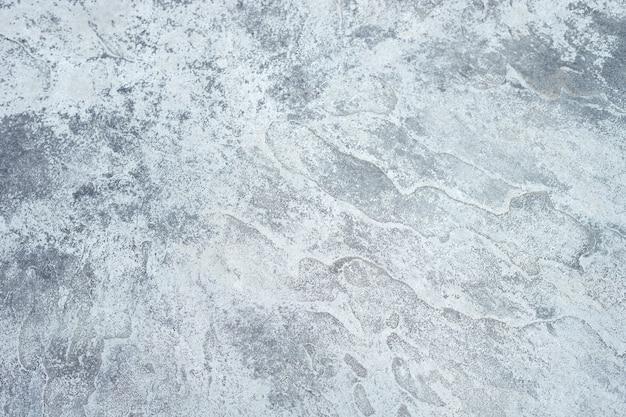 La trama ruvida del muro di cemento grigio. Foto Premium